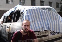 Сгоревшие в Донецке машины ОБСЕ
